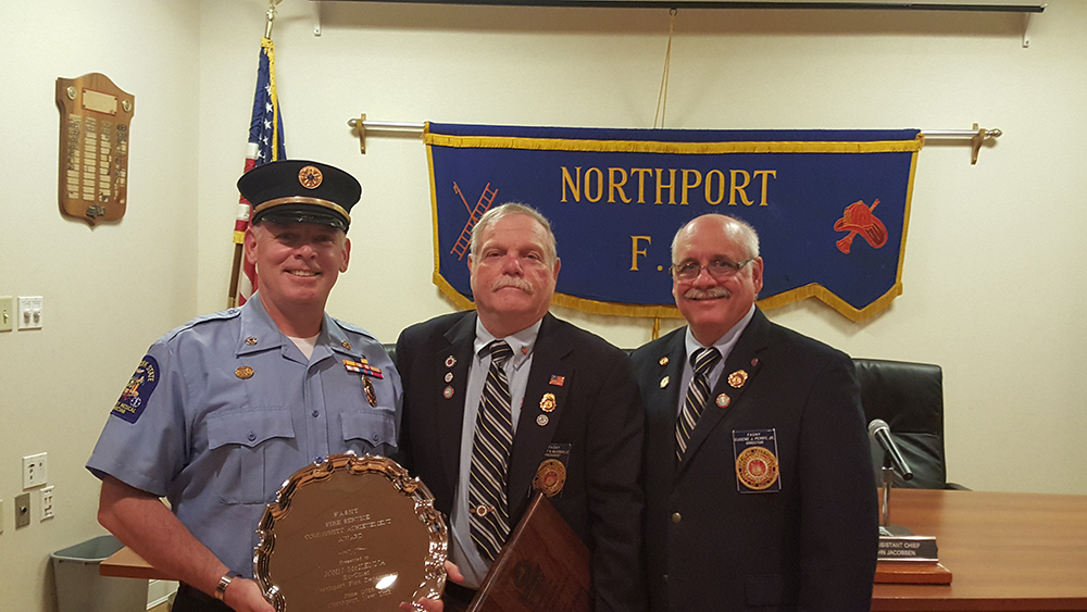 FASNY Award Ceremony at Northport Fire Department, 6/20/16 Left to right: John McKenna; FASNY President Robert McConville; FASNY Board of Directors Member Eugene Perry Photo credit: Northport Fire Department